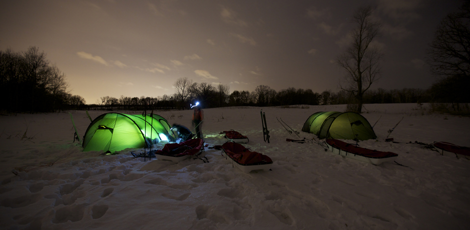Illuminated tents during a training overnight for North of Sixty