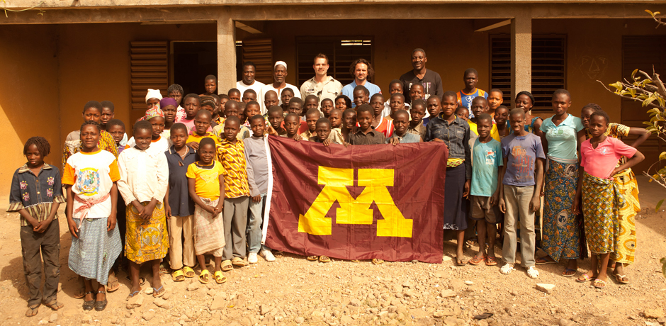Aaron visiting a school in Burkina Faso, Africa, with Earthducation