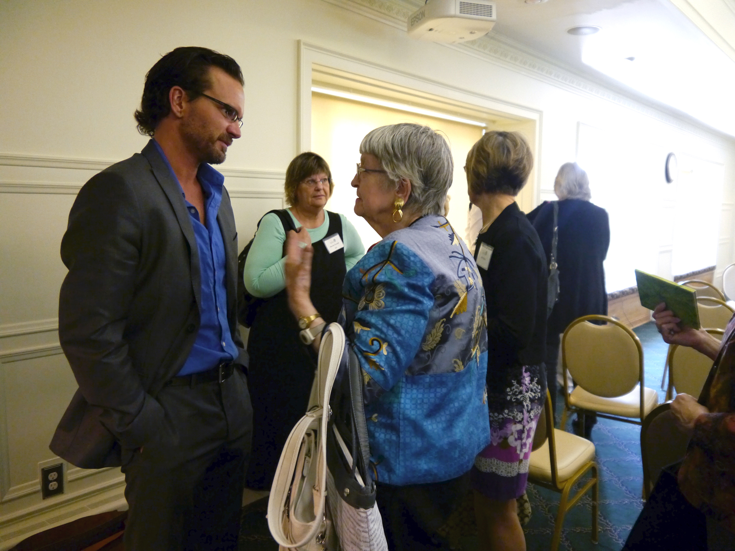 Aaron speaking with attendees after his keynote